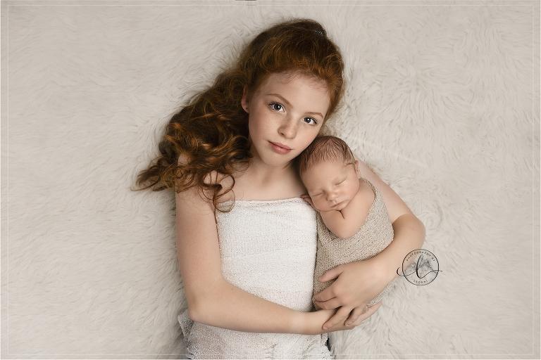 newborn sibling photos